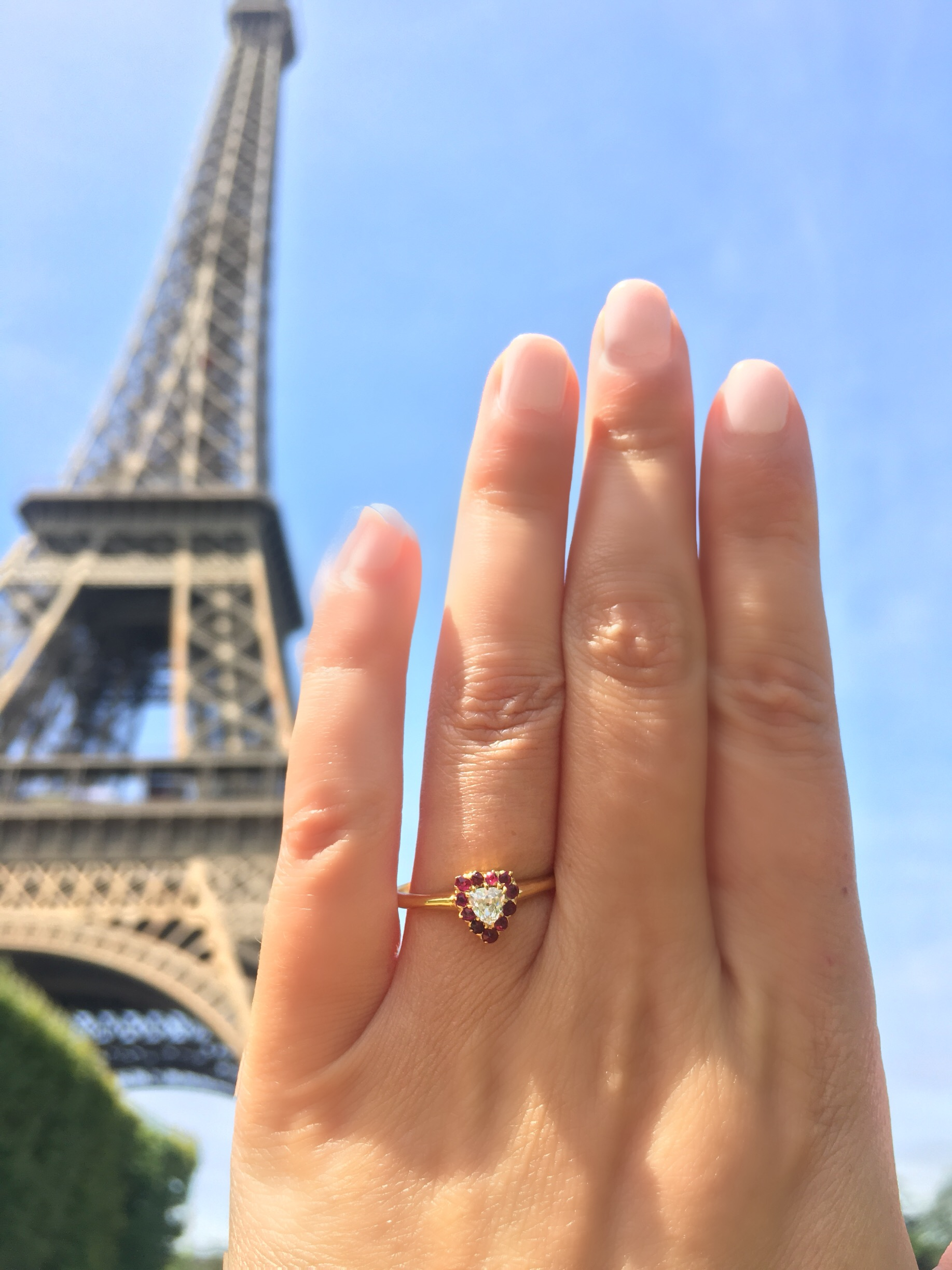 Heart-shaped engagement ring with Eiffel Tower in background