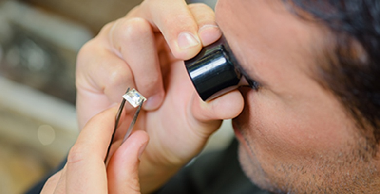 Jeweler appraising a diamond