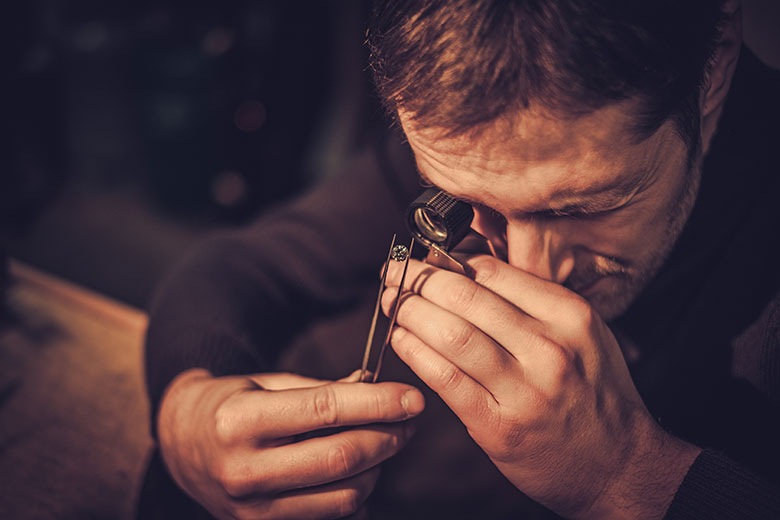Jeweler performing a ring appraisal