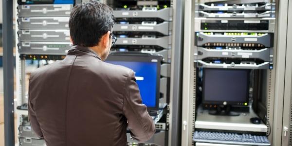 Man servicing computer network