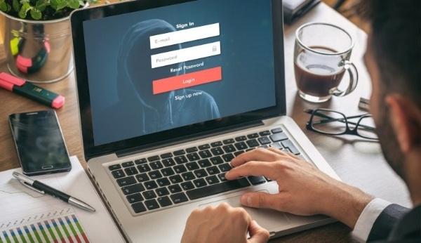 Computer hacker behind screen