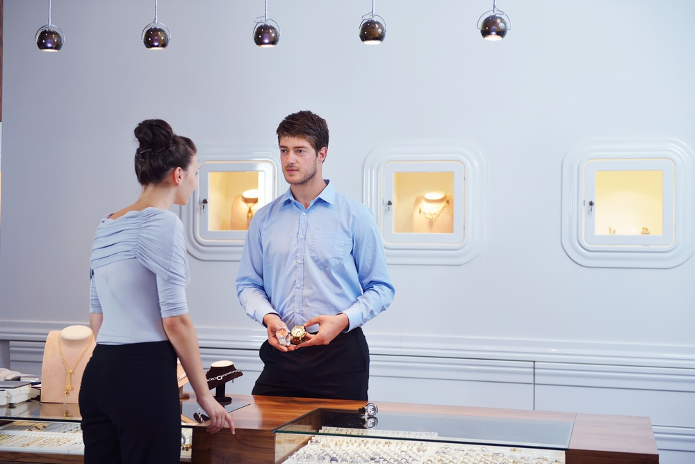 Salesperson learning how to sell jewelry securely