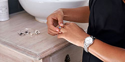 Place your ring in a designated spot while showering.