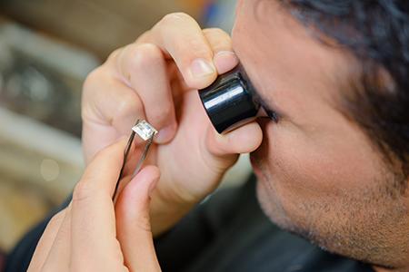 Jeweler Inspecting Diamond